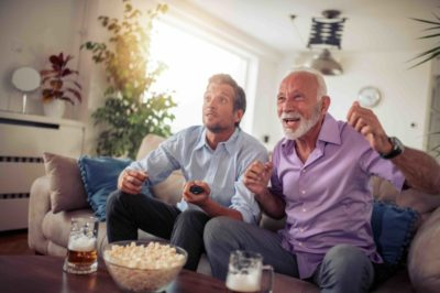 Two men watching football game