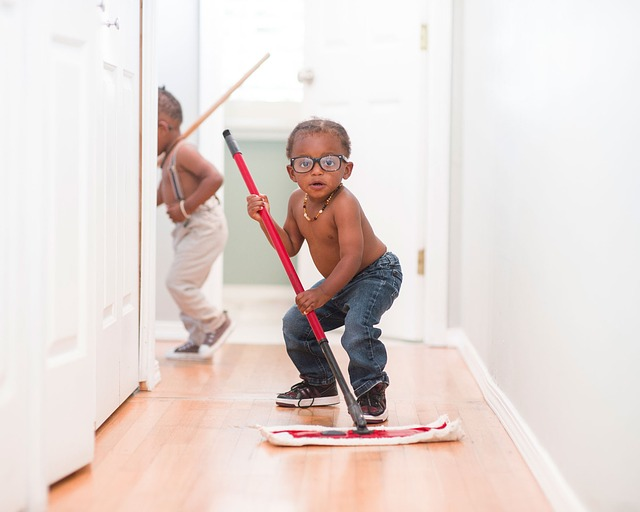 Kids mopping the floor cute with all natural floor cleaner